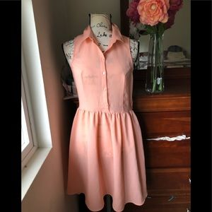 Divided /Cute dress  in a peach 🍑 color dress